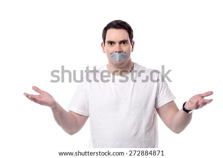 Casual man mouth covered by masking tape - stock photo
