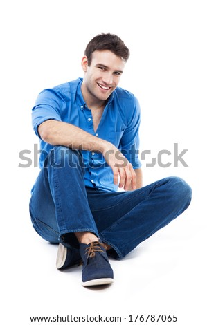 Casual man sitting  - stock photo