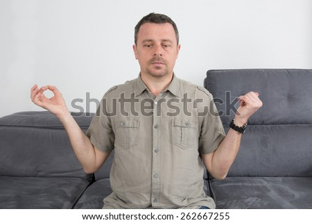 Casual man sitting in lotus position meditation