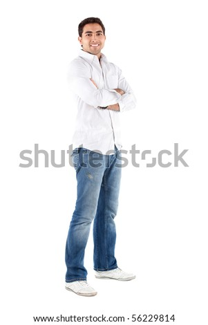 Casual man standing with his arms crossed - isolated over a white background - stock photo