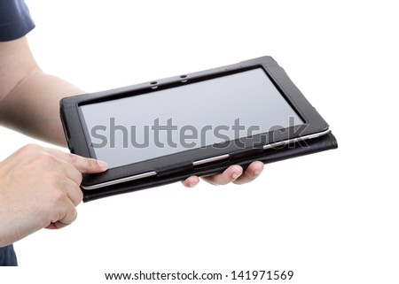 Casual man using touch pad, close up shot on tablet pc, isolated