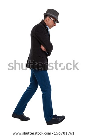 Casual man walking  - stock photo