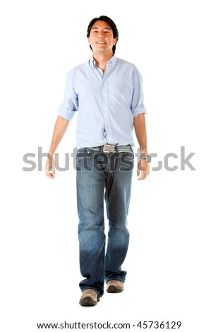 Casual man walking towards the camera isolated over a white background - stock photo