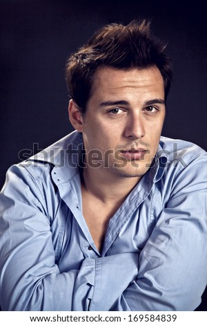 Casual man with arms folded - stock photo