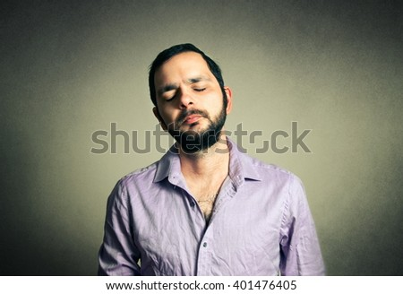 casual man with the beard with closed eyes