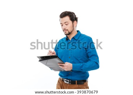 Casual man writing something in clipboard isolated on a white background