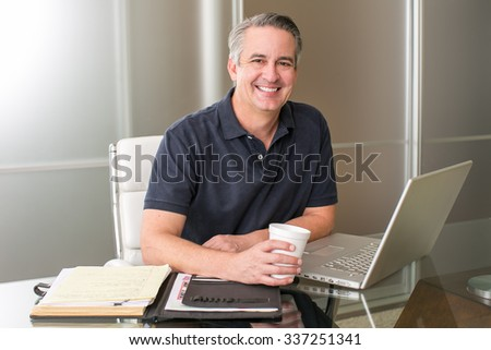 Casual mature business man working with coffee - stock photo