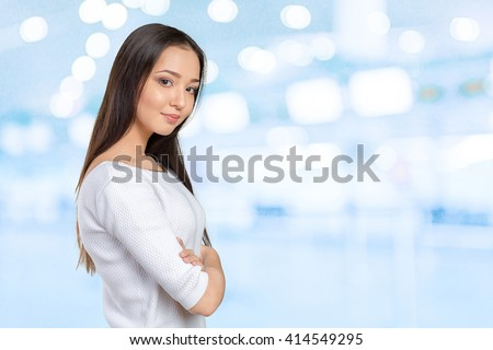 Casual mixed-race Asian Caucasian woman smiling looking happy - stock photo