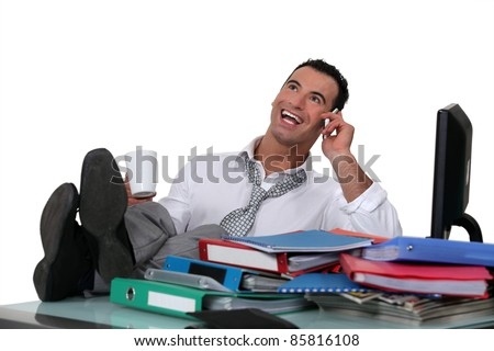 Casual office worker with feet on desk - stock photo