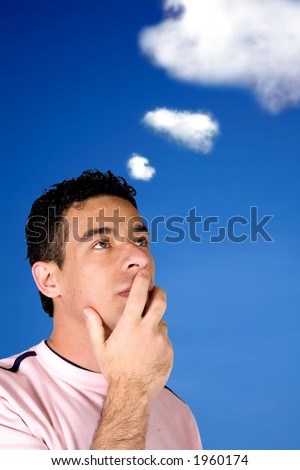 casual pensive man with the sky and clouds in the background - stock photo