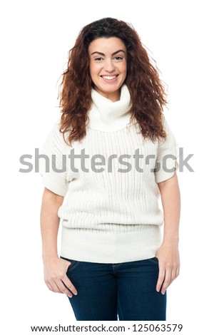 Casual portrait of a fashionable young woman wearing high neck sweater. - stock photo
