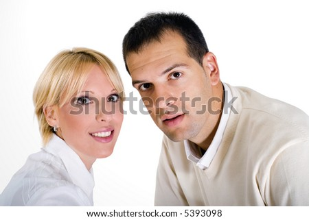 casual portrait of a happy couple in 20s, white isolated - stock photo