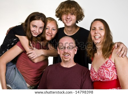 Casual portrait of a happy family isolated on white. - stock photo