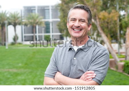 casual portrait of a mature, happy man taken outside - stock photo