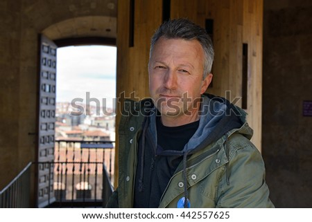 Casual portrait of handsome man, spring outdoor. - stock photo