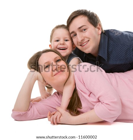 Casual portrait of happy young family of three isolated on white background - stock photo