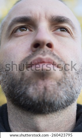 Casual sefie portrait of a adult beard man in vertical composition. - stock photo