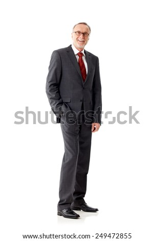 Casual senior business man standing on white background - stock photo
