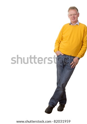 Casual senior businessman leaning relaxed against the edge of the frame, smiling confidently at the camera, isolated on white. - stock photo
