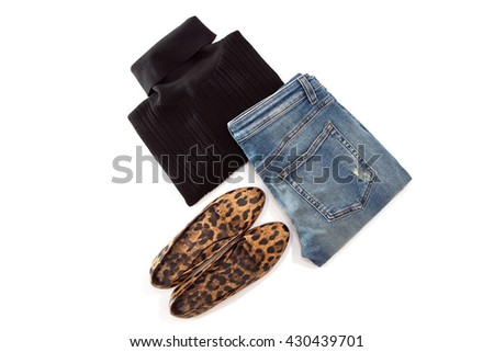 Casual set of women's black jersey, classic jeans and brown shoes with leopard print, isolated on white background