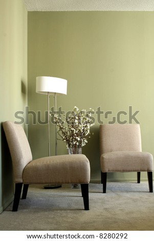 Casual slipper chairs with lamp and flowers