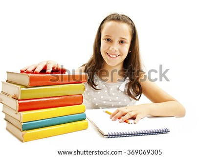 Casual student doing her homework. Isolated on white background - stock photo