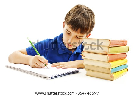 Casual student doing homework. Isolated on white background - stock photo