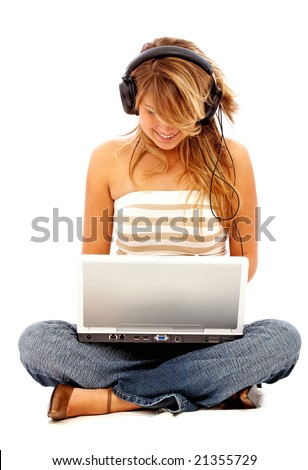 Casual student listening to music on the computer while studying isolated over a white background - stock photo