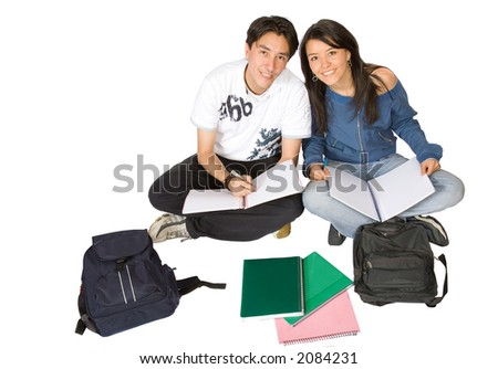 casual students studying on the floor over a white background - stock photo