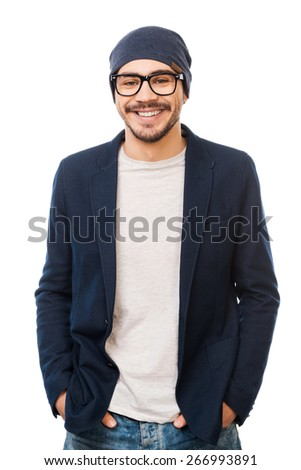 Casual style. Handsome young man in eyewear holding hands in pockets while standing against white background - stock photo