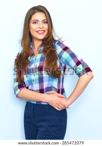 Casual style wear woman portrait against white wall. Plaid shirt. teenager style. Long hair.
