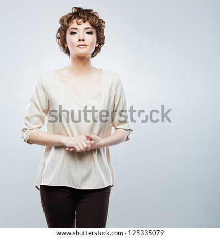 Casual style woman portrait. Beautiful girl studio posing. Young model isolated on gray background.