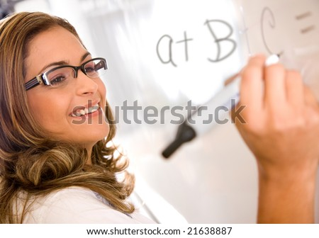 casual teacher or student writing on a white board - stock photo