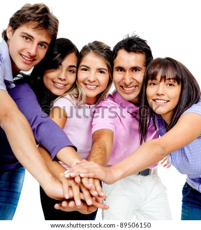 Casual team with their hands together in the middle - isolated over a white background - stock photo