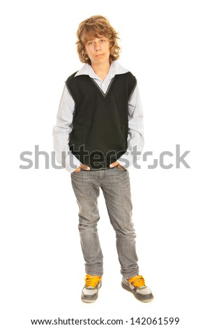 Casual teen schoolboy holding hands to pockets jeans isolated on white background - stock photo