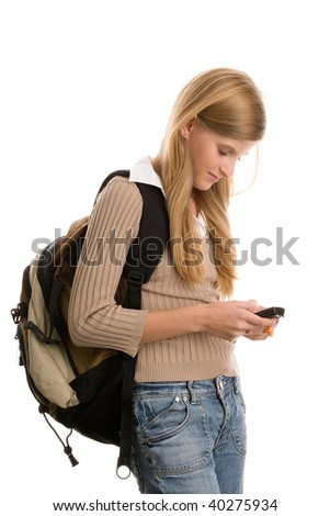 Casual teenage girl preparing to school using cell phone isolated on white background - stock photo