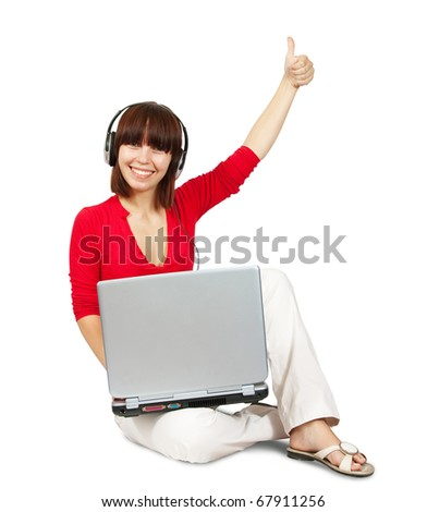Casual  teenager with laptop and headphones  over a  white  background