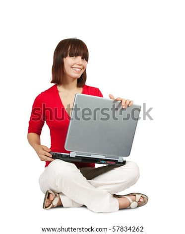 Casual  teenager with laptop  over a  white  background - stock photo