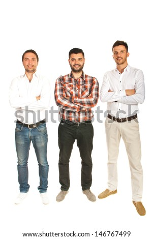 Casual three business men standing in a line with arms folded isolated on white background