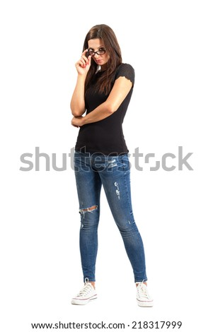 Casual trendy beauty looking above glasses. Full body length isolated over white background. - stock photo