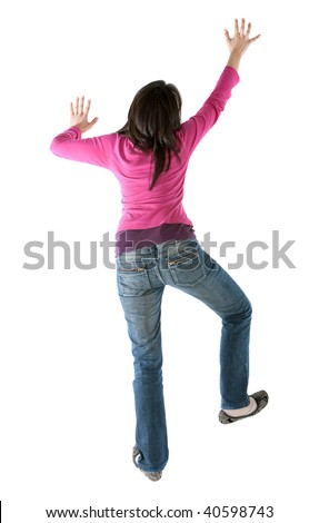 casual woman climbing a wall isolated over a white background - stock photo