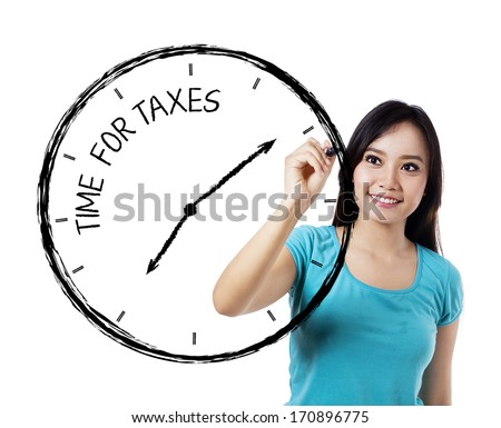 Casual woman drawing a time for taxes on transparent whiteboard - stock photo