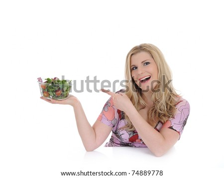 Casual woman eating healthy green vegetable salad. isolated on white - stock photo