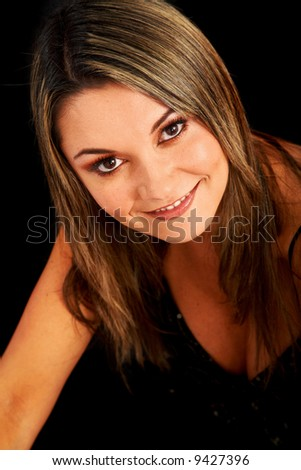 casual woman face smiling portrait isolated over a black background
