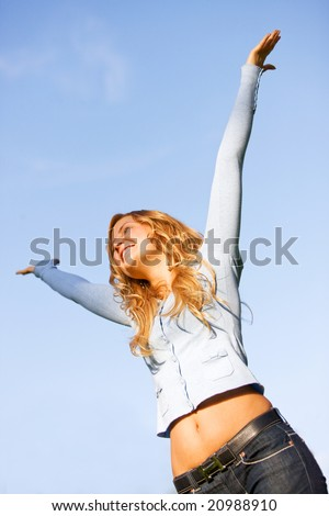 casual woman full of success smiling outdoors - stock photo