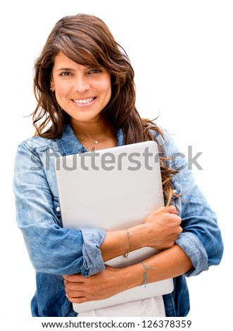 Casual woman holding a laptop - isolated over a white background