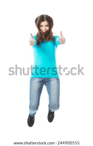 Casual woman jumping showing OK. Isolated on white. - stock photo