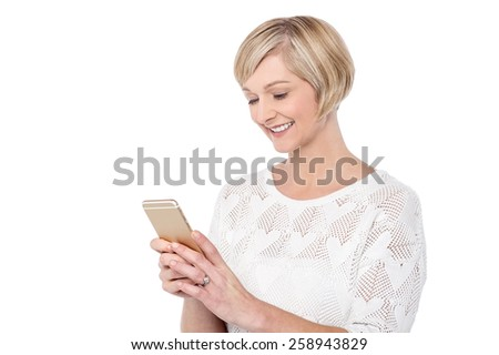 Casual woman messaging from her cellphone - stock photo
