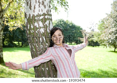 casual woman relaxing in park