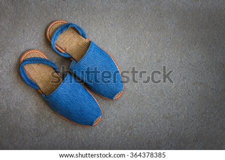 Casual woman shoes handmade with blue jean on gray grunge background - stock photo